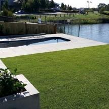 Sandhurst paving, retaining wall, synthetic grass, irrigation and gardens (Medium)
