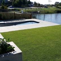 Sandhurst paving, retaining wall, synthetic grass, irrigation and gardens (Medium)